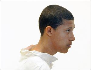 Philip Chism, 14, stands during his arraignment for the death of Danvers High School teacher Colleen Ritzer in Salem District Court in Salem, Mass., Wednesday.