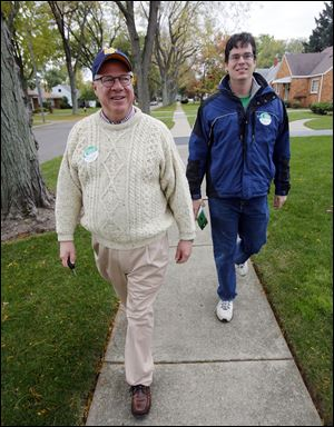 Toledo Councilman D. Michael Collins, a candidate for mayor, goes door to door with Steve Leggett. 'The younger members of my campaign are challenged to keep up with me day-to-day,' Mr. Collins says.