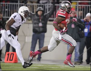 Ohio State running back Carlos Hyde, right, outruns Penn State safety Adrian Amos on his way to scoring a touchdown during the second quarter. Hyde rushed for 147 yards and two touchdowns. Ohio State is now 9-0.