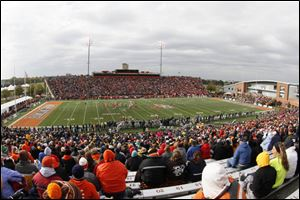 Fans watch as Bowling Green State University battles the University of Toledo during the first quarter.