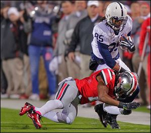 Penn State wide receiver Brandon Felder is tackled by Ohio State cornerback Bradley Roby on Saturday night in Columbus.