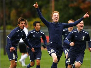 St. John's senior Adam Naayers (10) celebrates after scoring the game winning goal.