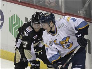 Nailer Carter Rowney (17) and Walleye Bobby Shea (8) vie for control of the puck during the second period.