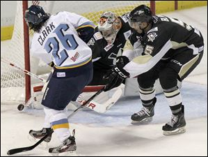 The second shot on goal in a row by Walleye Emerson Clark (26) is rebuffed by Wheeling goalie Mike Condon during the second period.