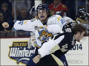 Walleye Emerson Clark (26) and Nailer Patrick McGrath (13) engage in a fight.