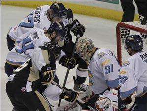 Walleye goalie Mac Carruth (31) blocks a shot on goal during the second period.