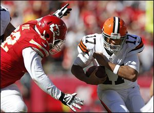 Chiefs nose tackle Dontari Poe, left, moves in to hit Cleveland Browns quarterback Jason Campbell during the first half Sunday in Kansas City.