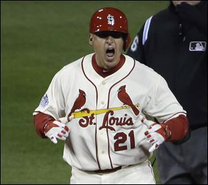 St. Louis Cardinals' Allen Craig reacts after hitting a double during the ninth inning Saturday night in Boston.