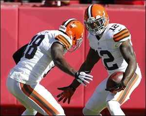 Cleveland Browns wide receiver Josh Gordon, right, celebrates his touchdown with teammate Greg Little during the first half Sunday in Kansas City.