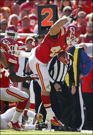 Chiefs fullback Anthony Sherman avoids a tackle on a touchdown run Sunday in Kansas City.