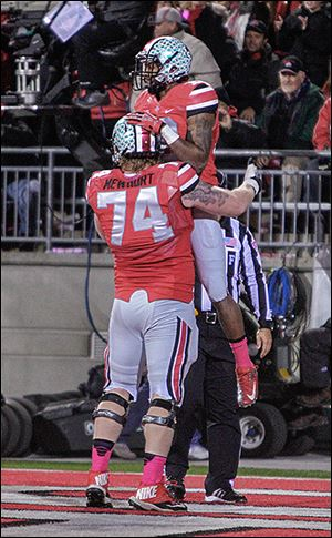 Ohio State offensive lineman Jack Mewhort congratulates wide receiver Corey Brown on his touchdown against Penn State during the second quarter.