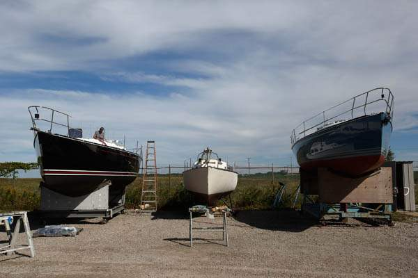 Three-custom-built-yachts-sit-in-dry-dock-at-Hanover-Marine-in-Fairport-Harbor