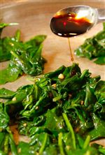 Soy-sauce-is-added-to-spinach-sauteed-in-garlic
