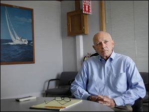 Steve Malbasa, owner of Hanover Marine, discusses the financial position of his company at its headquarters in Fairport Harbor.