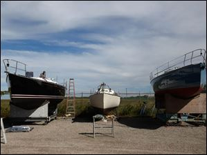 Three custom-built yachts sit in dry dock at Hanover Marine in Fairport Harbor.