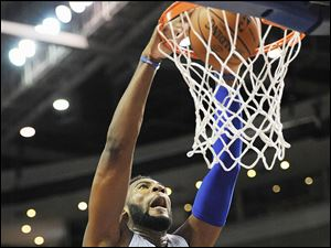 Detroit Pistons center Andre Drummond (0) dunks for two of his team high 17 points against Maccabi Haifa during the third quarter of an NBA preseason basketball game.