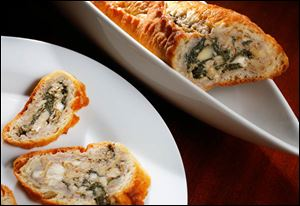 Spinach and artichoke-stuffed baguette slices.