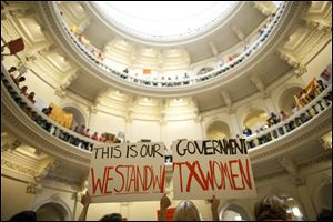 Abortion rights supporters rally on the floor of the State Capitol rotunda in Austin, Texas, in this July file photo.