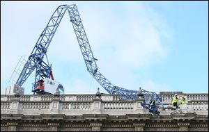 Engineers look at the damage as a crane working on redevelopment at the Cabinet Office in Whitehall, near to Downing Street in London, was brought down by high winds today.