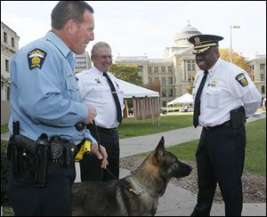 Toledo Police Chief Derrick Diggs, right, with one of the department's  German shepherds and two other members of the force.