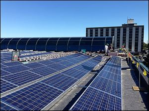 The 494 solar panels on Murray & Murray's roof cost $370,000, but is to be paid off in five years because of tax credits and incentives.