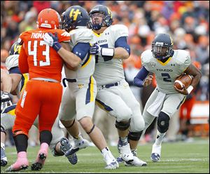 Toledo's Terrance Owens finds some running room against Bowling Green. The senior quarterback has thrown game-winning touchdowns in the past two games.