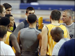 University of Toledo basketball coach Tod Kowalczyk, right, talks to his team during a recent practice. Kowalczyk says this is the deepest team he has had in 12 years of coaching.