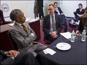 The Rev. Al Sharpton, left, meets with Mark Lee, center, CEO of Barneys New York, today at the National Action Headquarters in New York with store officials, community leaders and local politicians to discuss allegations of racial profiling after two black customers were detained by police outside the store after making expensive purchases.