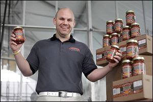 Donald Hill holds jars of his Brickyard Sloppy Joe sauce, sold at 26 retailers in northwest Ohio.