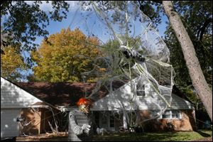 Paul and Noelle Zeisler, of West Toledo, have home built almost all their Halloween decorations, including a 20 foot tall spider web with a mummy in its center. Paul builds the spider web each year from scratch, using PVC pipe, rope and bagged cobwebs. He estimates the cost of building the web new each year to be between $75 and $100.