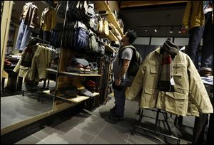A shopper browses at a Timberland store in Skokie, Ill., earlier this month.