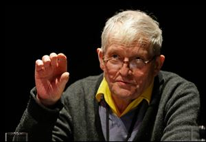 David Hockney gestures while explaining how he used an iPad to paint at an exhibit opening in San Francisco.