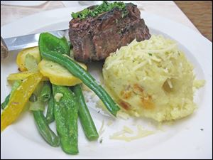 Grilled Filet with Bernaise sauced served with mashed potatoes and mixed vegetable from Del Sol in the Grand Plaza Hotel