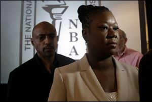 Sabrina Fulton, mother of slain teenager Trayvon Martin, leaves a news conference held by the National Bar Association in Florida in July.