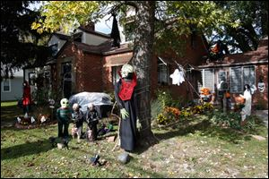Jane Ochoa, of North Toledo, has spent the better part of a week assembling and putting up her various Halloween decorations. With everything ranging from skeletons to aliens to the Wicked Witch, Ochoa's front yard is ready for the holiday.