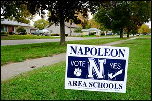 A yard sign urges voters in Napoleon to support a 2.9-mill, five-year school levy. Tuesday will mark the district's latest attempt to secure new operating funds.