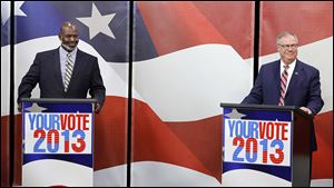 Incumbent mayor Mike Bell and City Councilman D. Michael Collins started out the  live televised mayoral debate with smiles at the WGTE studio in Toledo. But after the night's questions on the city's issues ranging from state of neighborhoods to city finances by Blade and WTVG-TV panelists, their exchanges became tense.
