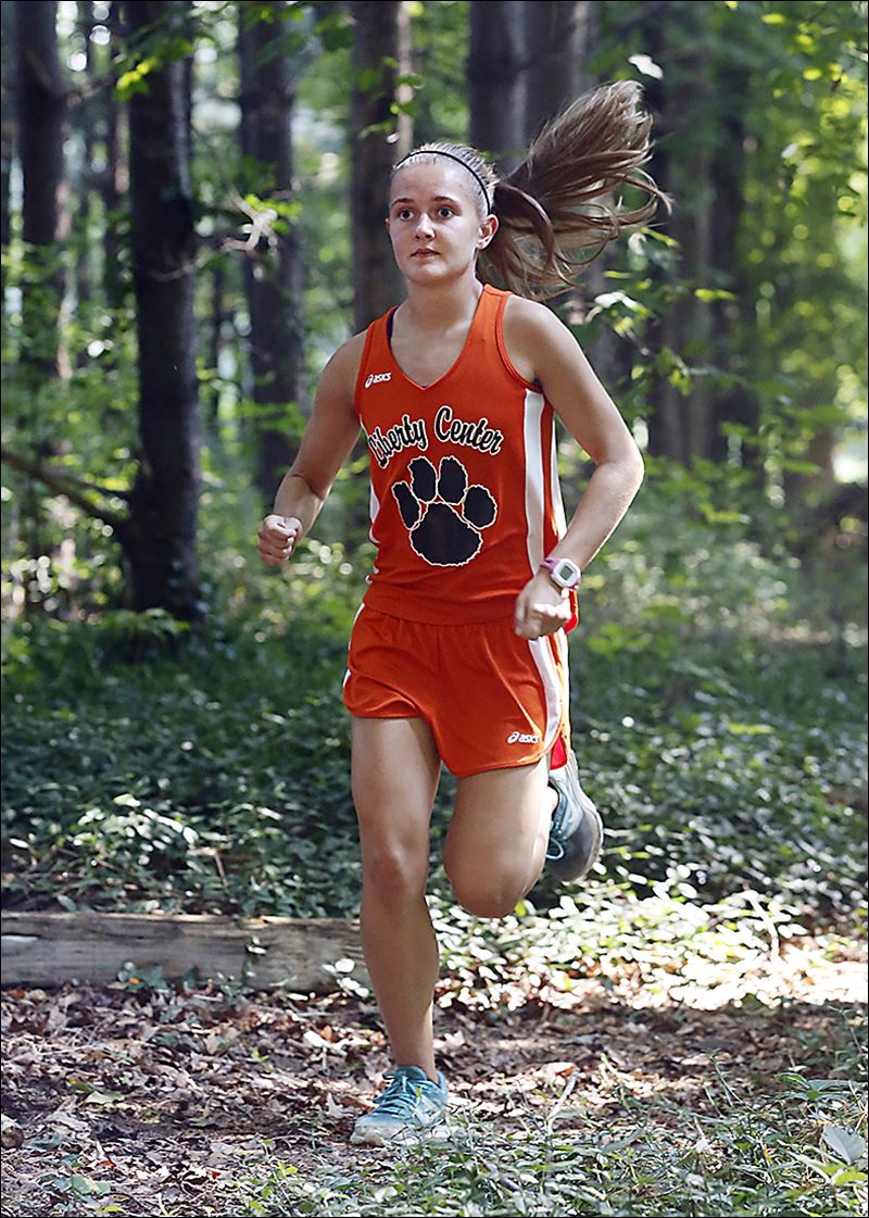 center cross girls Tim atkinson, who has been the head cross country coach the past 10 seasons, is helping to carry on the winning tradition at liberty center high school.