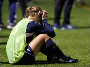 Notre Dame's Casey Paluch sit on the sidelines while her team falls behind against Anthony Wayne.