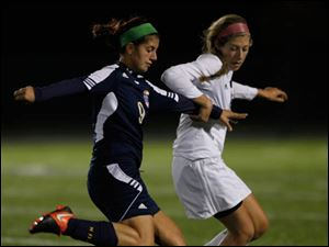 Notre Dame's Natalie Deeb, left, and Anthony Wayne's Chloe Brown battle for control of the ball.