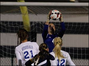 Anthony Wayne's goalkeeper Taylor Hill earns a save. Players are, from left, Anthony Wayne's Sarah Petrell, Notre Dame's Dani Johnson, and AW's Katelyn Bixler.