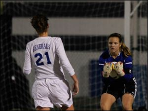 Anthony Wayne's Sarah Petrell watches AW goalie Taylor Hill make a save.