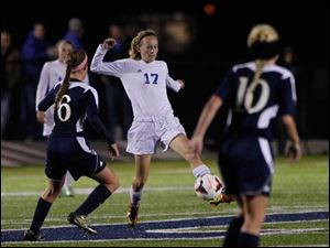 Notre Dame's Kassidy Rejent (6), watches Anthony Wayne's Kendall Schmucker kick the ball up the field.