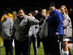 Anthony Wayne head coach Lori Williams instructs her players from the sidelines.