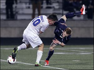 Anthony Wayne's Zach Harris, left, and St. Johns' Adam Naayers collide. The Generals improved to 16-0-4.