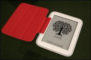 Barnes & Noble's new e-reader, Nook GlowLight, is demonstrated in New York. The GlowLight has an electronic ink touch screen, which has better battery life and less glare than typical tablet screens. The red cover is an optional accessory.