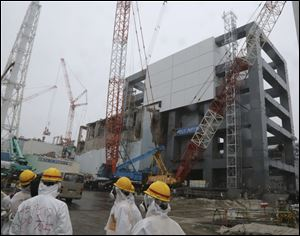The steel structure for the use of the spent fuel removal from the cooling pool is seen at the Unit 4 of the Fukushima Dai-ichi nuclear plant at Okuma in Fukushima prefecture, Japan in June.