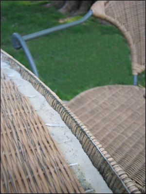 Freeze-thaw cycles damage patio furniture like this faux-rattan set when left outside unprotected.