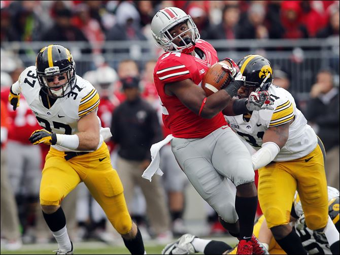 31s5hyde-4 Ohio State's Carlos Hyde gets past Iowa's Anthony Hitchens, right. Hyde has 590 yards on 88 carries with seven touchdowns this year.