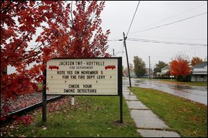 A sign outside the Jackson Township-Hoytville Fire Department encourages residents to support a two-year .75-mill levy for the department's operation.
